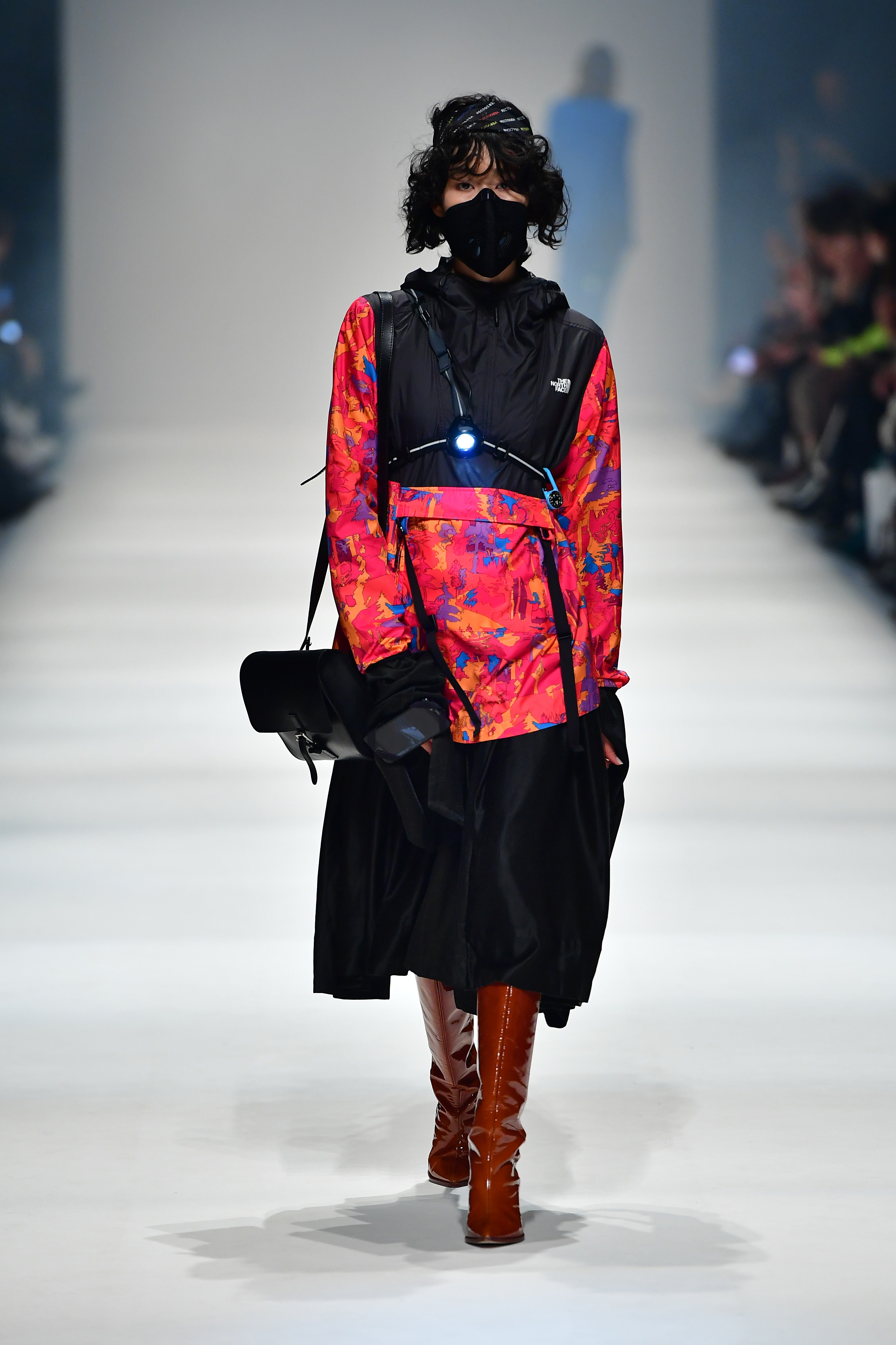BERLIN, GERMANY - JANUARY 14: A model wearing a jacket by The North Face, dress by Høyem, bag by Ackermann, headband by Recto Verso and shoes by Alinaschuerfeld walks the runway at the Neonyt show during Berlin Fashion Week Autumn/Winter 2020 at Kraftwerk Mitte on January 14, 2020 in Berlin, Germany. (Photo by Alexander Koerner/Getty Images for MBFW)